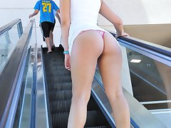 Madeline flashes tits and ass at the mall